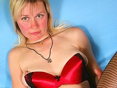 Horny blonde housewife reaching to a climax