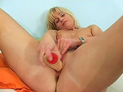 Sultry blonde wife copes with her rubber friend