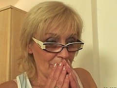 The granny in glasses looks great with a young dick fucking her wrinkled old pussy
