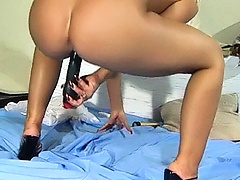 Seductive horny mom, playing with her favorite ribbed black pocket rocket.