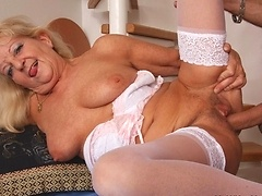 The graceful granny seduces him with a kiss and a smile and he is soon pounding her pussy hole