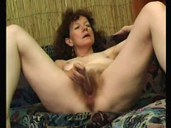 Raunchy old bitch lets a big sex toy into her slit