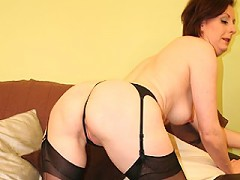 English housewife playing with a rubber dildo
