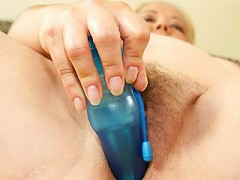 Chubby mature slut playing with her dildo