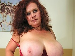 Big titted housewife getting nasty on herself
