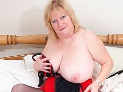 Big breasted mature Fiona gets wet and dirty